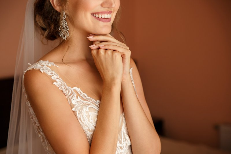 Closeup of bride smiling in wedding gown